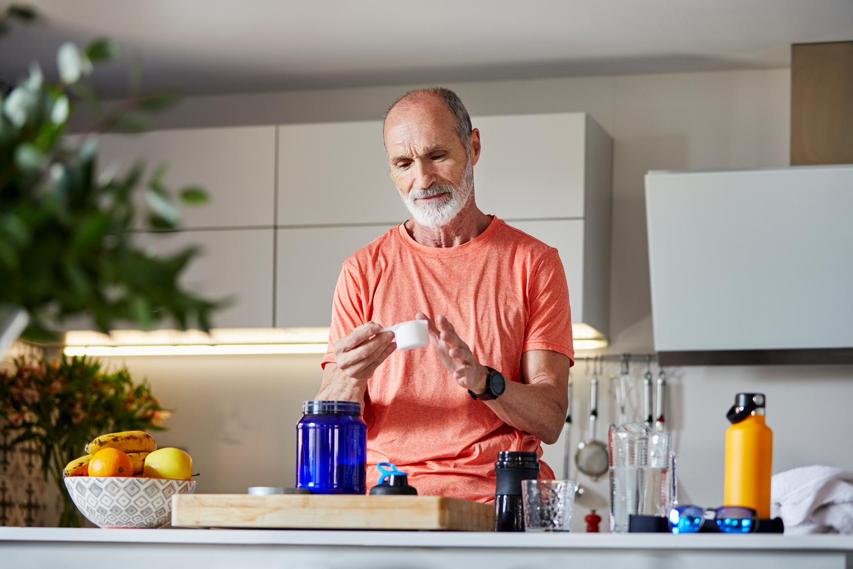 Active Senior Man Preparing Protein Drink