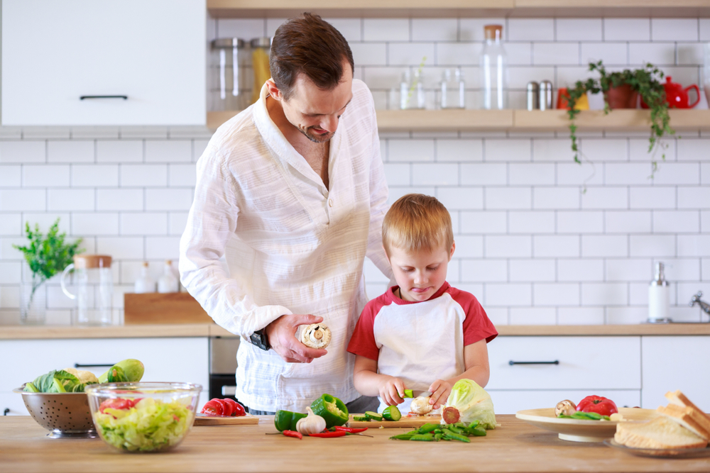 Family Meal Planning father son chopping vegetables